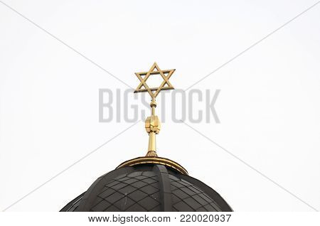 metal Star of David on the roof of the church building.