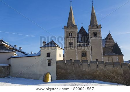 Ancient Spisska Kapitula and Saint  Martin Cathedral ( Spis Chapter house , known as the Slovak Vatican ) on background blue sky at winter. Spisske Podhradie, Slovakia, UNESCO World Heritage Site. Tourist attraction