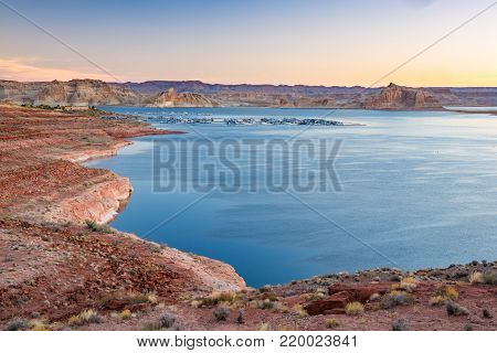 Sunrise near Wahweap Marina on Lake Powell in Page, Arizona.  Lake Powell is part of the Glen Canyon National Recreation Area formed by the Glen Canyon Dam along the Colorado River