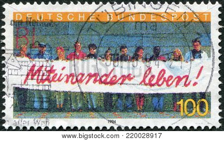 GERMANY - CIRCA 1994: A stamp printed in the Germany, depicts Foreigners in Germany with a banner
