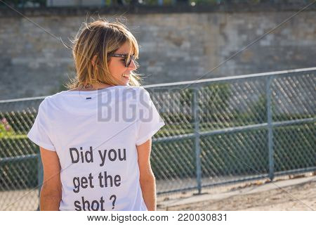 Helena Bordon. STREETSTYLE: French fashion blogger, Helena Bordon arrives with a huge smile at the Nina Ricci show at Jardins Des Tuileries on September 25, 2014 in Paris, France. The back of Helena's t-shirt pokes fun at photographers with the phrase Did