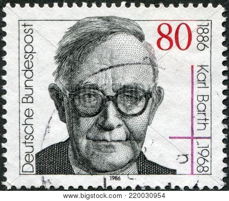 GERMANY - CIRCA 1986: A stamp printed in the Germany, dedicated to the 100th anniversary of the birth Karl Barth, circa 1986