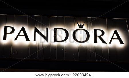 GIESSEN  GERMANY DECEMBER 2017: Illuminated Logotype of the brand Pandora. Pandora is an international Danish jewelry manufacturer and retailer.