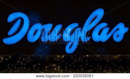 GIESSEN  GERMANY DECEMBER 2017: Illuminated  Logotype of DOUGLAS.  DOUGLAS is a perfumery chain based in Düsseldorf, Nordrhein-Westfalen.