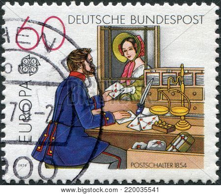GERMANY - CIRCA 1979: A stamp printed in Germany, shows the Post Office window, 1854, circa 1979