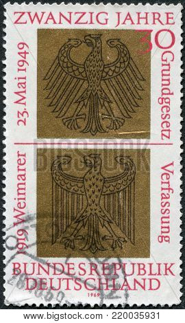 GERMANY - CIRCA 1969: A stamp printed in Germany, dedicated to 20th anniversary of the German Basic Law and the 50th anniversary of the proclamation of the Weimar Constitution, shows a Heraldic Eagles of Federal and Weimar Republics, circa 1969