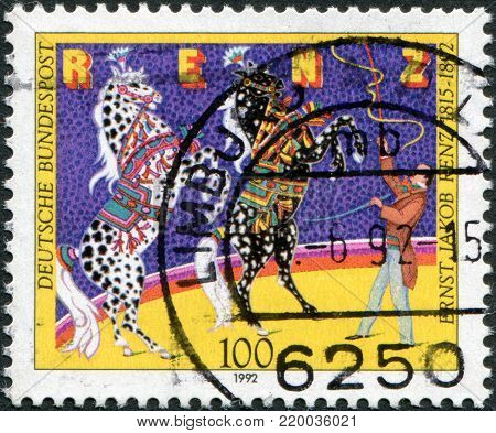 GERMANY - CIRCA 1992: A stamp printed in Germany, is dedicated to Ernst Jakob Renz (1815-1892), Circus Director, shows the training of horses, circa 1992