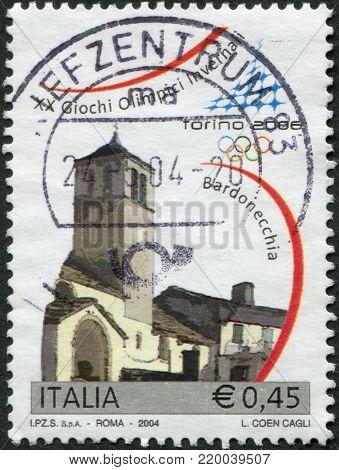 ITALY - CIRCA 2004: A stamp printed in Italy, is dedicated Winter Olympics, Turin, shows San Pietro Apostolo Church, Bardonecchia, circa 2004