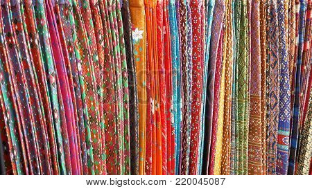 Colorful Sarongs Clothes with Assorted Patterns Background