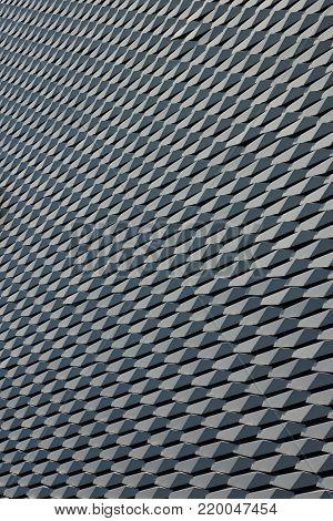 Hexagonal alloy facade pattern in vertical