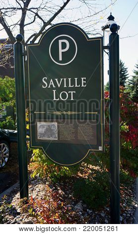 PETOSKEY, MICHIGAN / UNITED STATES - OCTOBER 18, 2017: Motorists may park their vehicles on the Saville Parking Lot in downtown Petoskey.