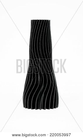 Abstract object of black color printed by 3d printer isolated on white background. Fused deposition modeling, FDM. Progressive modern additive technology. Concept of 4.0 industrial revolution