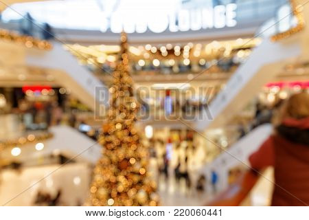 Christmas Trade and Shopping in multi-story Shopping Mall blurred background