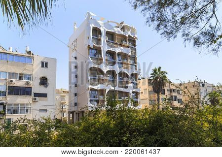 TEL AVIV, ISRAEL - SEPTEMBER 17, 2017: The Crazy House is a residential building with architecture that has bizarre shapes distinct from any other architectural style of the city.