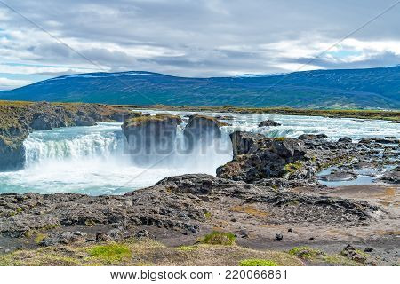 Godafoss waterfall, or waterfall of the gods - Northern Iceland. The water of the river Skjalfandafljot falls from a height of 12 meters over a width of 30 meters.
