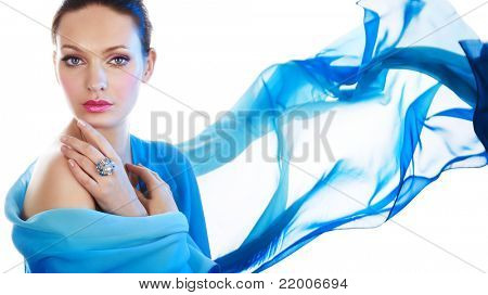 Beautiful woman with ring and blue color scarf