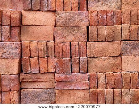 Background of Pile of Neatly Arranged Construction Bricks