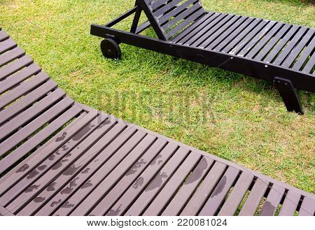 Outdoor Wooden Daybed On The Green Lawn