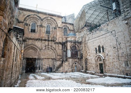 Church of the holy sepulchre in Jerusalem during a snow storm