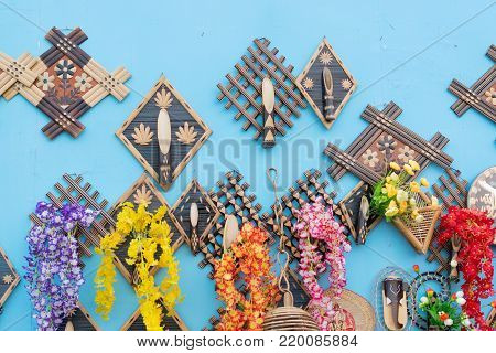 Colorful decorative wall hangings, handicrafts on display with white background during the Handicraft Fair in Kolkata - the biggest handicrafts fair in Asia.