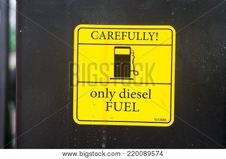 Warning sign on agricultural machinery. ATTENTION. Only diesel fuel.