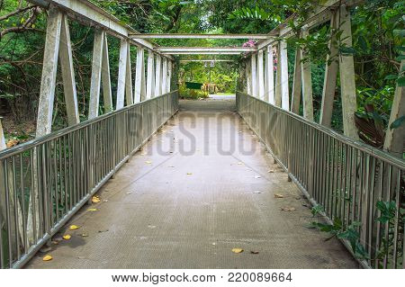 Architecture of footbridges or walkway for walking overpass cross over the river in the park. (Selective focus)