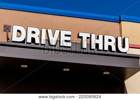 White and Blue Drive Thru sign set against a blue sky I