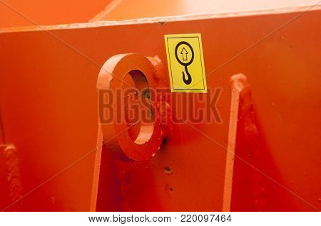 Warning sign on agricultural machinery. Place hook hook. Place of the pile.
