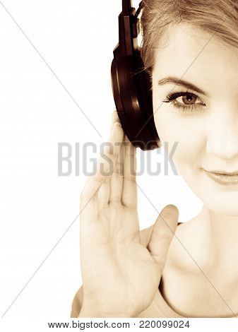 Woman casual style big headphones listening music mp3. Smiling female model on white. People leisure happiness concept.