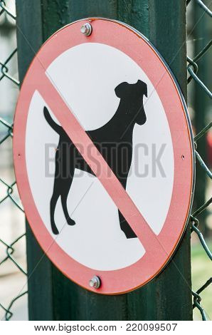 The signs forbidding walking the dogs. Closeup