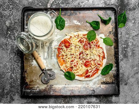 Unprepared Pizza With Ingredients.