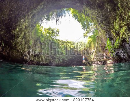 Upolu Island, Western Samoa, South Pacific - October 27, 2017: Tourists in the To Sua Trench - the volcanic swimming hole is a popular travel destination.