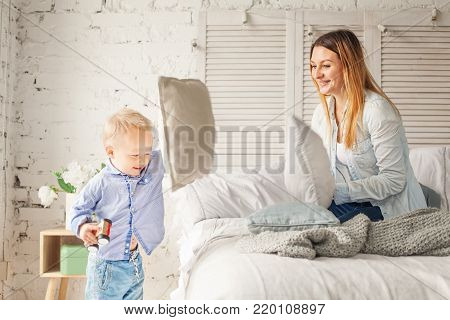 Pillow Fight. Happy Mother and Son Having Fun at Home. Woman and Child Boy, Happy Family