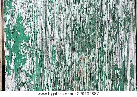 Corroded green  blue metal background. Rusty green painted metal walls. Rusty metal background with streaks of rust. The rust spots, texture