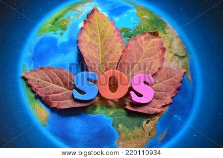 word sos on an abstract colored background