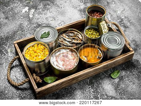 Different Canned Products In Tin Cans.