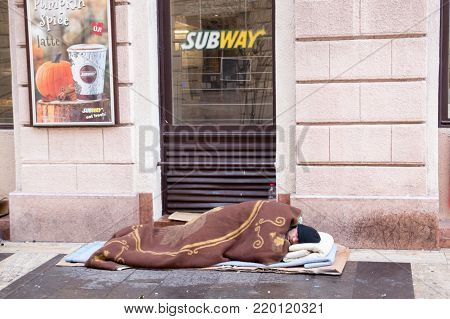 HUNGARY, BUDAPEST, 05,09,2017 A homeless man sleeps in front of the store entrance