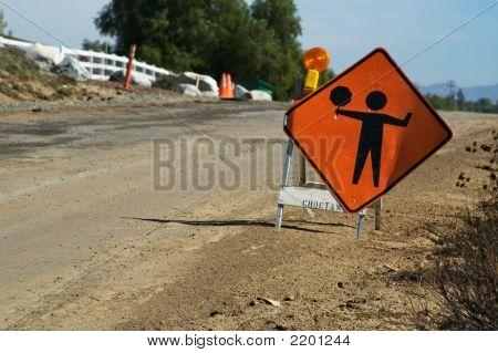 Men Working Sign In A Construction
