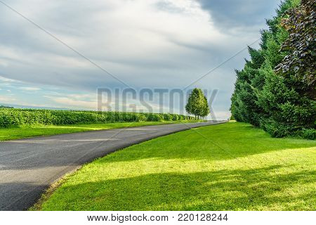 Amish country road, field agriculture in Lancaster PA US