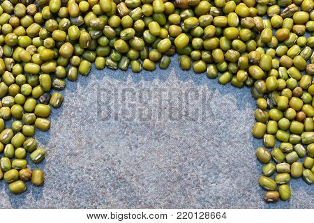Whole green mung beans background with copy space.