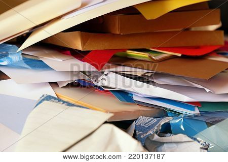 Pile of colorful scrapbook papers and card. Messy pile of papers to declutter with space for text.