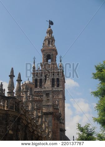 Sevilla, Spain.  July, 11 2014.  The Seville cathedral dome with bell tower.  The Giralda is the bell tower of the Cathedral of Seville
