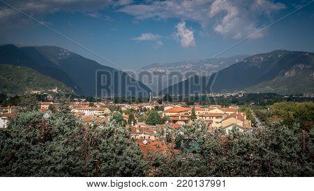 Cityscape Of Bassano Del Grappa With Mediteran Style Houses And Hills In The Background Alpini In Vi