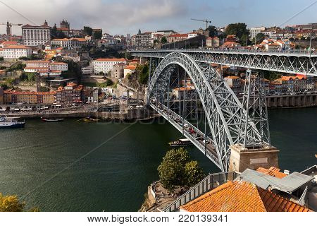 Porto, Portugal, August 16, 2017:  The Dom Luis I Bridge, a double-deck metal arch bridge, constructed in 1886, spans the River Douro between the cities of Porto and Vila Nova de Gaia in Portugal.