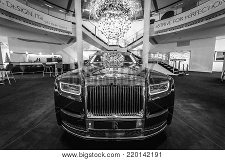 BERLIN - DECEMBER 21, 2017: Showroom. Full-size luxury car Rolls-Royce Phantom VII Series II Extended Wheelbase. Since 2012. Black and white.