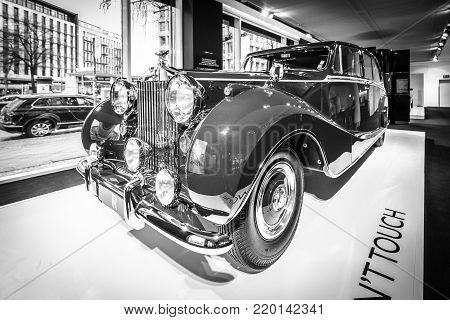 BERLIN - DECEMBER 21, 2017: Showroom. Luxury car Rolls-Royce Phantom IV sedanca de ville limousine, 1952. Coachwork by Hooper of London. Former owner Sir Sultan Muhammed Shah, Aga Khan III. Black and white.