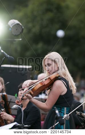 ROSTOV-ON-DON, RUSSIA - 10 SEPTEMBER 2017. Performance of the Rostov Academic Symphony Orchestra on the Public Library site. oloist of the orchestra.