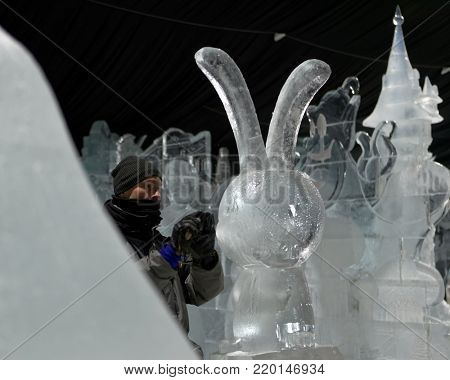 ST. PETERSBURG, RUSSIA - DECEMBER 19, 2017: Sculptor prepares the statue of hare for the opening of the festival Ice Fantasy - 2018. This year 180 tonnes of ice was used for creating ice compositions