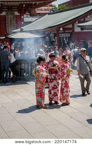 Tokyo - Japan, June 19, 2017; Tourists at Edo era Hozomon entrance of Sensoji, also known as Asakusa Kannon Temple, Asakusa