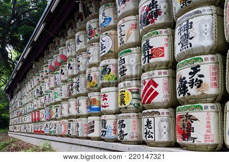 Tokyo -  Japan, June 18, 2017:  Sake barrels donated to the Meiji Jingu Shinto shrine by worshippers of the shrine in Shibuya, Tokyo